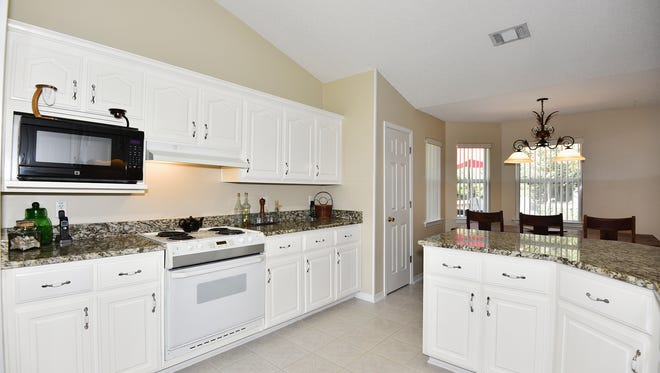 8050 Castle Point Way, open and bright kitchen.