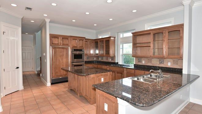 16314 Tarpon Drive, open kitchen with an island.