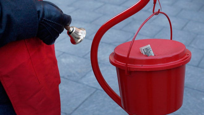 Dan Ponder, CEO of Franco Public Relations  Group, rings the bell to kick off the 2014 Salvation Army  Red Kettle fundraising campaign in Cadillac Square  on Friday, Nov. 7, 2014. Diane Weiss/Detroit Free Press