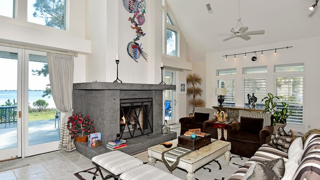 1409 Soundview Trail, the great room with a fireplace and a view.