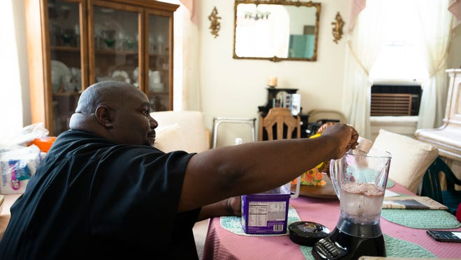 Rev. William Enoch McCoy makes himself a protein shake as part of his diet on Thursday, Dec. 10, 2015, in Montgomery Ala.