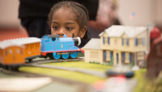3-yr-old RJ White of Rochester watches as a model train goes by on its track, during the  annual RIT Tiger Tracks Show & sale, held Saturday, Dec. 15, 2015, at Gordon Field House on the RIT campus.
