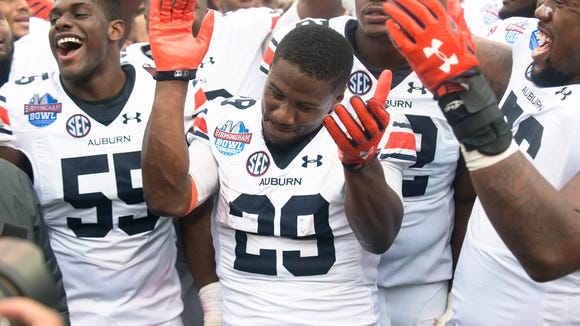 Auburn running back Jovon Robinson (29) claps during the NCAA football game in the Birmingham Bowl on Wednesday, Dec. 30, 2015, at Legion Field in Birmingham, Ala.