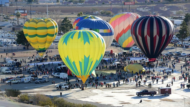 Bright colored balloons prepare to take to the skies above Mesquite at the 2015 Mesquite Hot Air Balloon Festival.