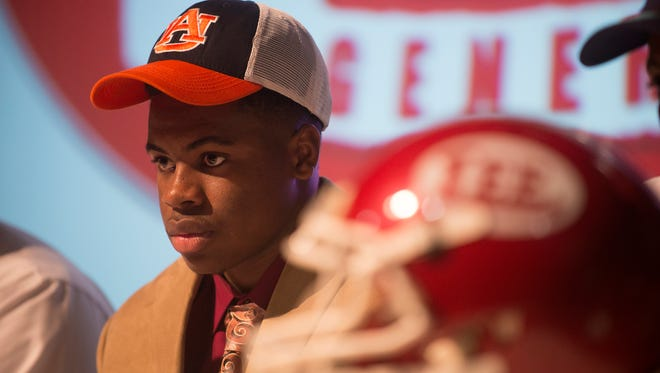 Daniel Thomas sits after signing with Auburn over Minnesota during Lee High School's signing day ceremony on Wednesday, Feb. 3, 2016, at Lee High School in Montgomery, Ala.