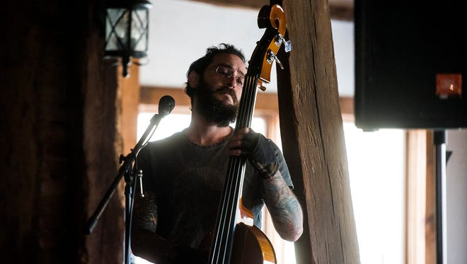 Dave Brumberg, with the band The Brummy Brothers, performs on upright bass at the Battlefield Brew Works in Gettysburg on Saturday Feb. 6, 2016 during Gettysburg Rocks.