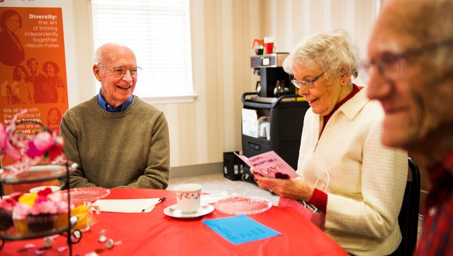 John Flynn, of Hanover, watches his wife, Audrey, read a Valentine's Day card from fourth graders at Washington Street Elementary school Thursday during the Senior Sweetheart Tea hosted by State Rep. Kate Klunk at the Hanover YWCA. John and Audrey Flynn have been married for 58 years and the pair met at the Hanover YWCA when they were in high school. 'This is like a homecoming,' said John Flynn.