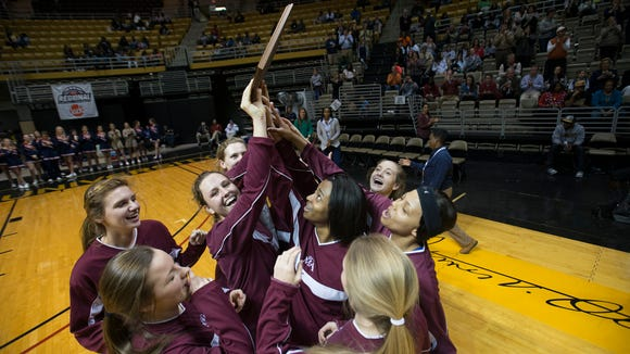 Montgomery Academy's Kayla White (22), center right,