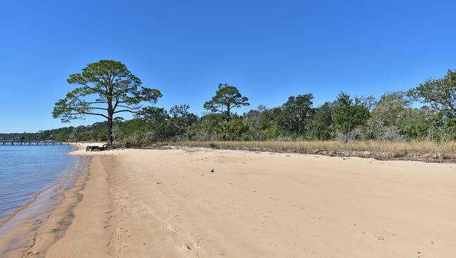 5160 Gull Point Road, the property included a spacious, private beach area.