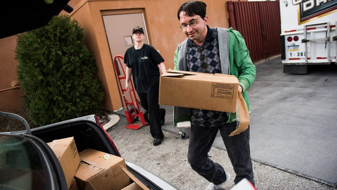Kent Hoffmaster, a volunteer for the Hanover Area Council of Churches, loads boxes of food into his car while picking up donations from Olive Garden and Longhorn Steakhouse on Friday March 11, 2016 on Wilson Avenue in Hanover.