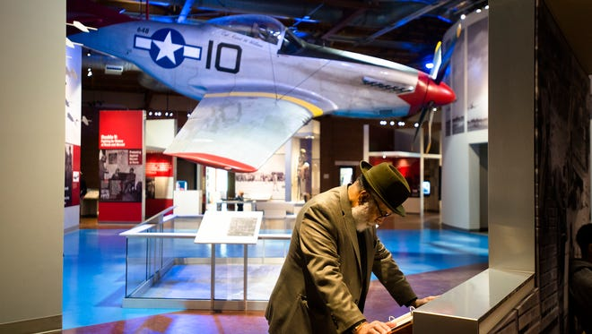 Lt. Col. retired Mat Santos looks through the Tuskegee Airmen Museum during the Tuskegee Airmen 75th Anniversary celebration on Tuesday, March 22, 2016, at Moton Field in Tuskegee, Ala.