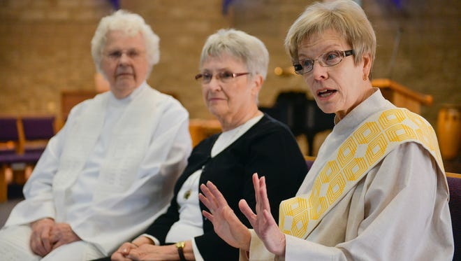 Ruth Lindstedt, right, who will be ordained April 10, talks along with Rose Henzler, studying to become a womanpriest, and the Rev. Bernie Sykora, a womanpriest, Tuesday, March 22 at St. John's Episcopal Church in St. Cloud. Mary Magdalene, First Apostle, a local womanpriest community, celebrates Mass at the church in St. Cloud once a month.