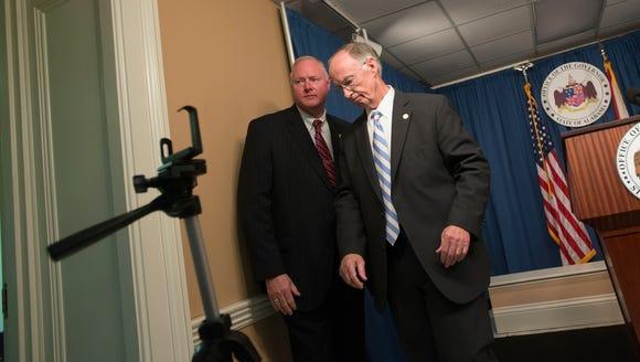 Governor Robert Bentley speaks to members of the press