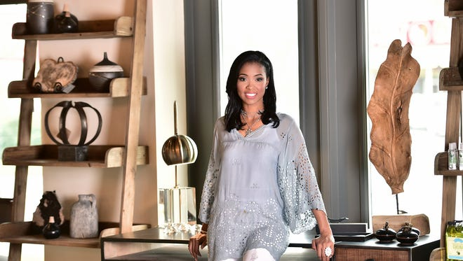 Model: Monifa Love.Shopping ListAn oversized Avy tunic (Johnny Was, $238) works in many settings. The sacred jewelry, available at Aqua Decor and Design, is beautiful and meaningful. Earrings are encased opal studs and sales of the Chavez for Charity bracelets benefit a local non-profit.