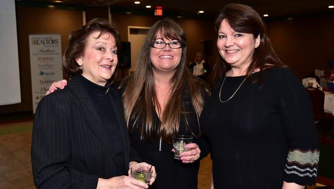 Carol Brown, Barbara Barlow and Kim Brown, at the Women's Council of Realtors Top Gun Celebration.