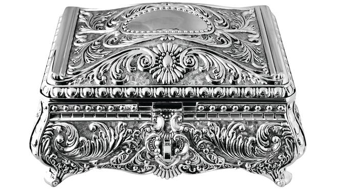 Repousse silver jewelry box, $195, at Jackson Hill Antiques.