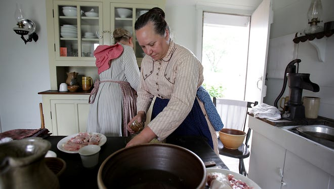 Cheryl Zielman, 59, of Wyandotte makes fried chicken for a fourth of July picnic using only what they had in 1876 at the Ford family home, during the Salute to America event at Greenfield Village in Dearborn on Friday, July 3, 2015.