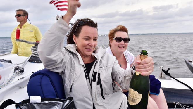 Lisa Sharp and Colleen Shannon pop some bubbly while Captain Kirk keeps us on course.