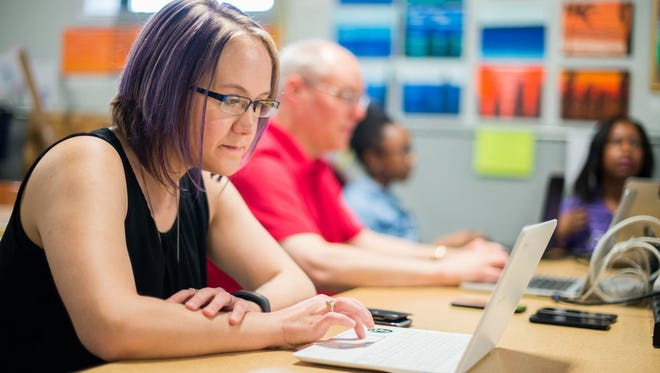 Katrina Rex, 35, of Gates partipates in a weekend short-course at Rochester Makerspace, designed to teach non-technical peole how to build a smart phone app. The course was being taught by RIT Associate Professor of Engineering & Technology Clark Hochgraf.