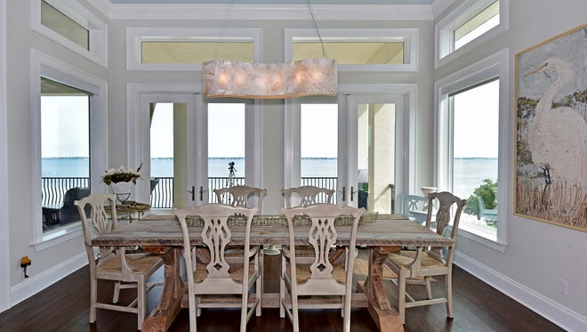 23 Sugar Bowl Lane, the dining space overlooks the shoreline.