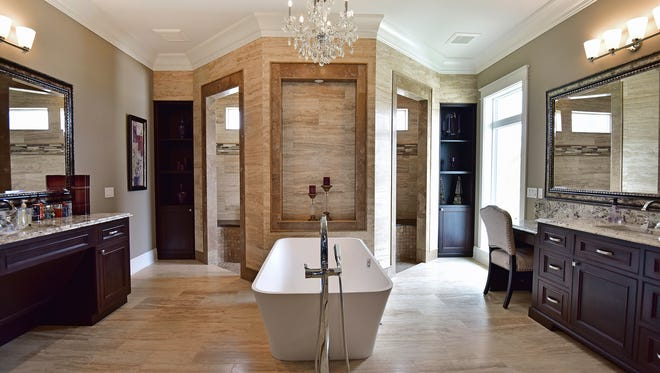 The expansive master bath is perfect spa-like escape for the homeowners.