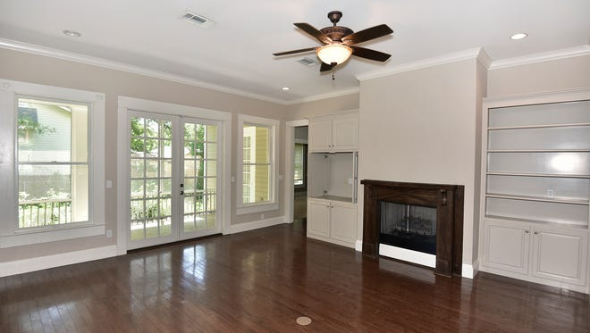 1520 18th Avenue, French doors lead from the living area to the screened patio.