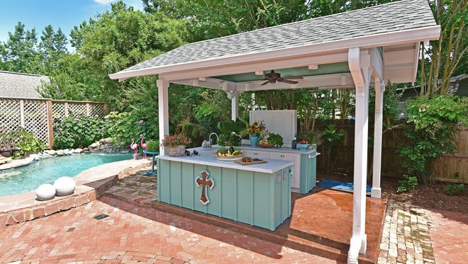 Laura's outdoor kitchen is conveniently locarted near the pool.