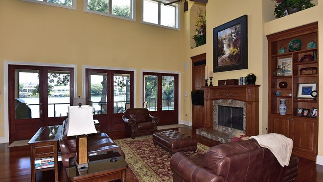 90 Fairpoint Drive, the open living room with a fireplace and patio access.