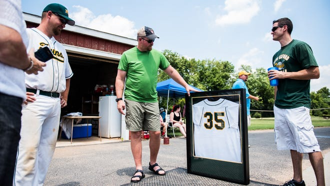 Keith Bevenour looks over his retired New Oxford Twins jersey Saturday July 23, 2016 before the start of New Oxford's game.