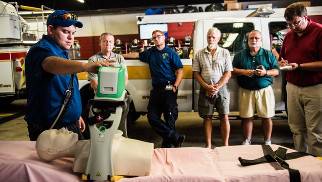 Matt Barnes, left, an EMT with Adams Regional Emergency Management Services, demonstrates how an automated compression device, called a Lucas device, is used for cardiopulmonary resuscitation Thursday Aug. 4, 2016 at United Hook and Ladder Fire Company in New Oxford.