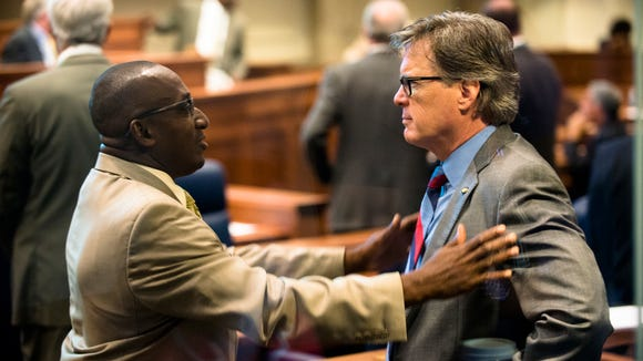 Bobby Singleton, D-Greensboro, left, speaks to Bill Hightower, R-Mobile, during discussion of the Lottery Bill at the legislative special session on Thursday, August 26, 2016, at the State House in Montgomery, Ala.