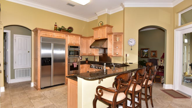 1333 Upland Crest Court, the gourmet kitchen with bar seating.