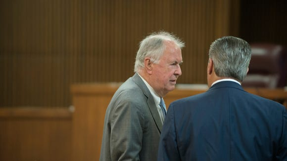 Bill Baxley speaks to Mike Hubbard, former Alabama Speaker of the House, before a post trial hearing at the Lee County Justice Center in Opelika, Ala., on Friday, Sept. 2, 2016. Hubbard was found guilty 12 counts of felony ethics charges on June 10, 2016.