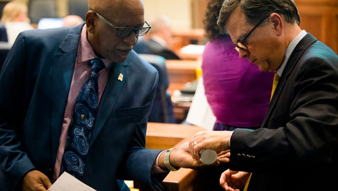 Senator Rodger Smitherman, D-Birmingham, receives candy from Senator Arthur Orr, R-Decatur,  during discussion of the BP oil spill settlement money during the special legislative session on Tuesday, Sept. 6, 2016, in Montgomery, Ala