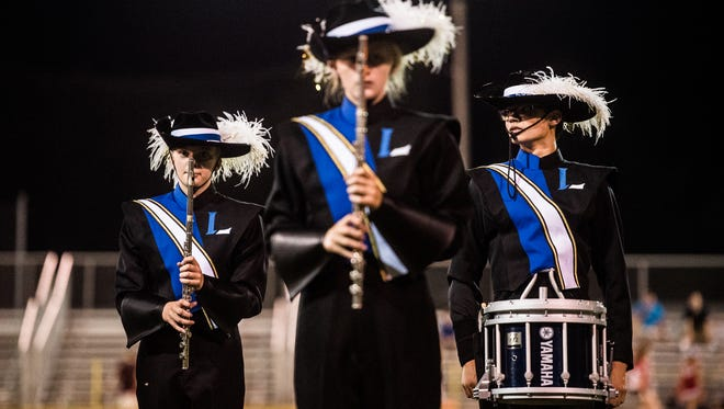 The Littlestown High School Marching Blue Band  performs their half-time show during a recent football game at Littlestown High School.