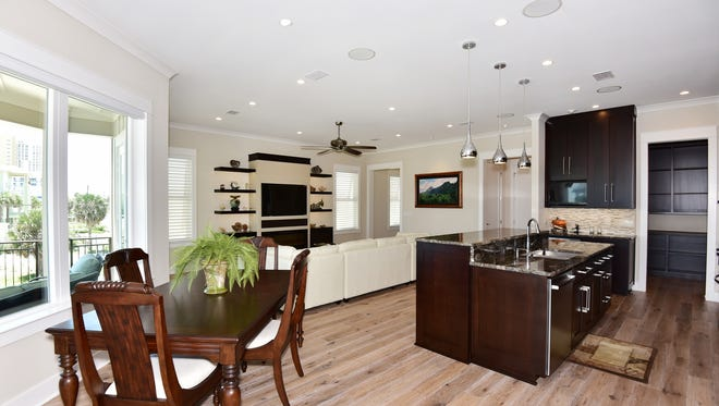 201 Ariola Drive, the kitchen, dining space and living area flow seamlessly into one another.