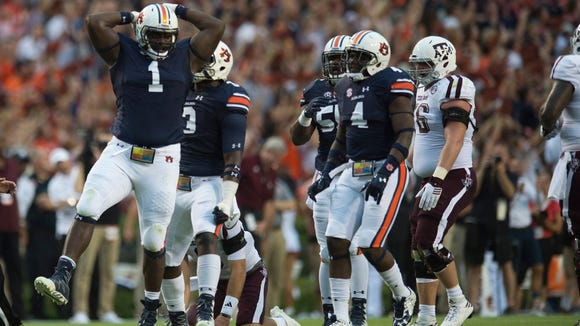 Auburn defensive lineman Montravius Adams (1) celebrates