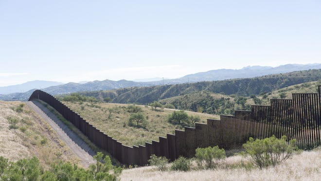 The United States has spent billions in increasing security along the border with Mexico, including this enhanced fence in Nogales, Ariz.