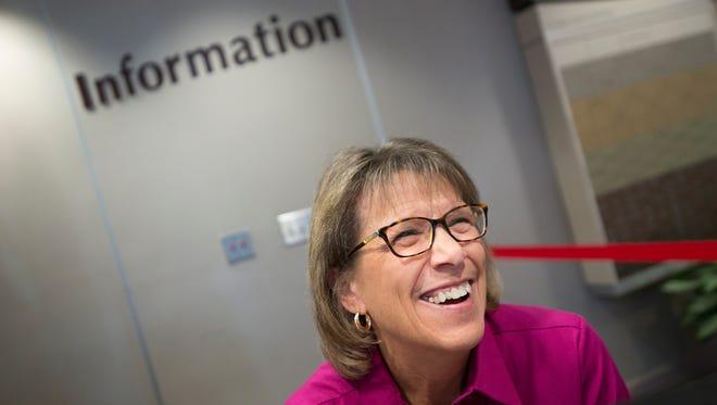Susan Lee volunteers at the information desk at Jackson Hospital on Thursday, Sept. 29, 2016, in Montgomery, Ala.