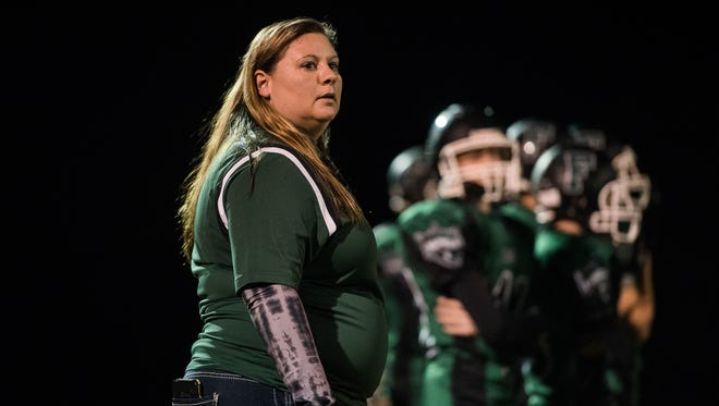 Fairfield athletic director Crystal Heller works on the sidelines Friday night Oct. 14, 2016 during Fairfield High School's Friday night football game against York County Tech. Heller is the only female athletic director in the YAIAA.