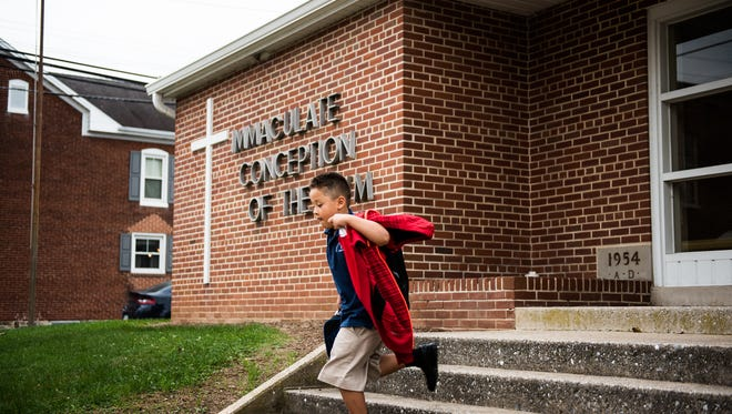 A student runs out of the Immaculate Conception of the Blessed Virgin Mary in New Oxford at the end of the school day on Friday. Immaculate Conception will combine with Annunciation of the Blessed Virgin Mary in McSherrystown and Sacred Heart of Jesus in Conewago Township to form a new school for the 2017-18 year.