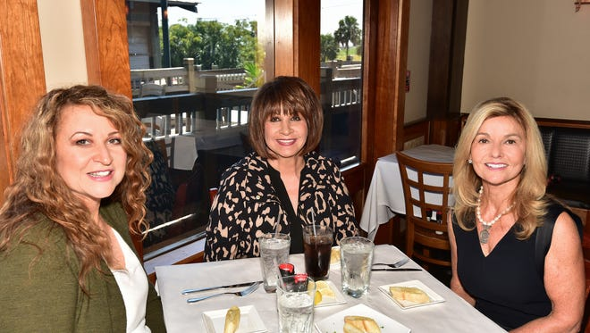 Pensacola businesswomen Caron Sjoberg, Sheilah Bowman and Shirley Cronley mix some business with lunch at The Fish House.
