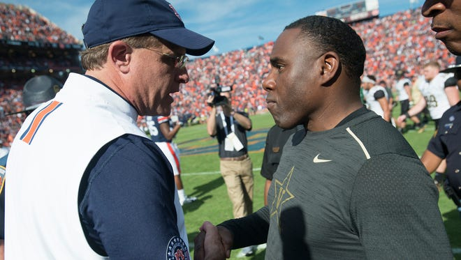 Auburn head coach Gus Malzahn greets Vanderbilt head coach Derek Mason after the NCAA football game between Auburn and Vanderbilt Saturday, Nov. 5, 2016, at Jordan-Hare Stadium in Auburn, Ala. Auburn defeated Vanderbilt 23-16.