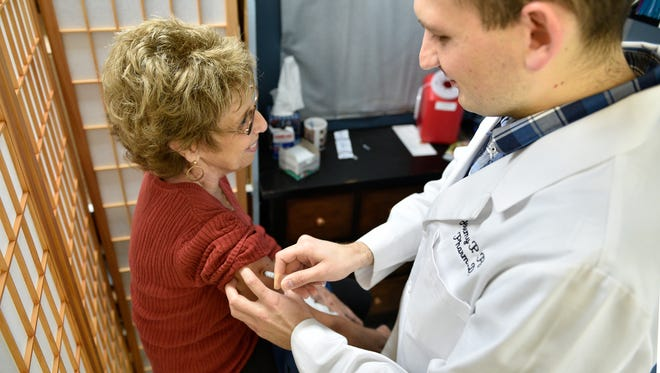 Pharmacist Jeremy Post give Tana Vance a flu shot on Saturday, Nov. 5, 2016, at Park Avenue Pharmacy in Chambersburg. It is important to get a flu shot before the season so your body can build immunity.