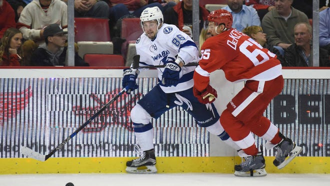 Lightning right wing Nikita Kucherov (86) and Red Wings defenseman Danny DeKeyser (65) skate after the puck during the second period Tuesday at Joe Louis Arena.
