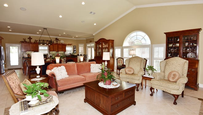 The family room is comfortable and includes a secretary that was John's mothers.