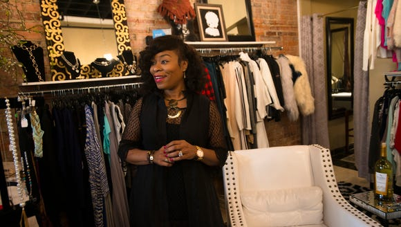Iyishia Jones, owner of Ishi?, stands in her store