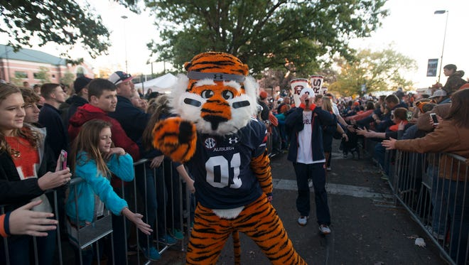 Aubie points while walking in Tiger Walk before the NCAA football game between Auburn vs. Alabama A&M Saturday, Nov. 19, 2016, in Auburn, Ala.