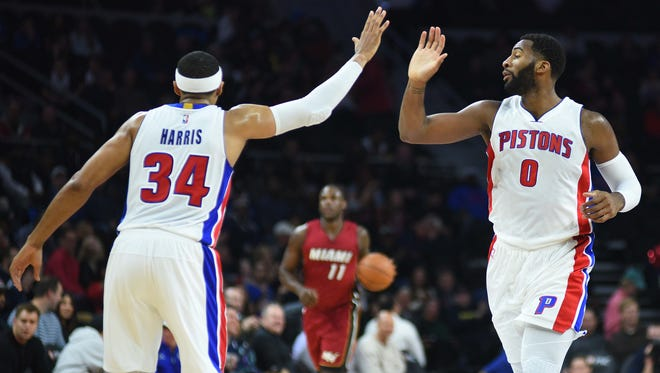 Pistons center Andre Drummond (0) high-fives forward Tobias Harris (34) during the third quarter of the Pistons' 107-84 win over the Heat Wednesday at the Palace.