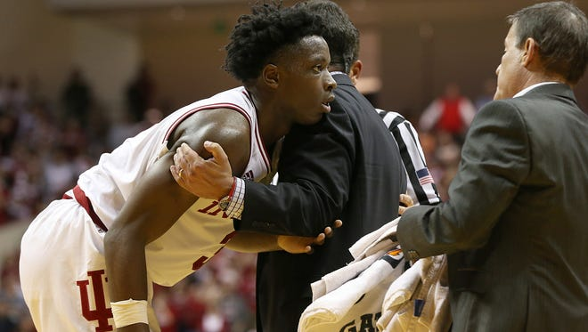 IIndiana Hoosiers coach Tom Crean helped forward OG Anunoby stand after he twisted his ankle during second half action between the Hoosiers and the North Carolina Tar Heels on Wednesday at Assembly Hall.